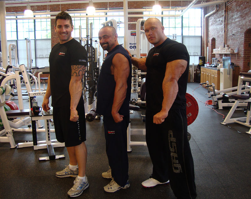 Lee, Charles, and Ben comparing tricep size at the Poliquin Strength Institiute.