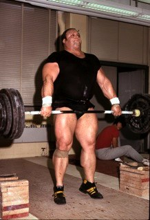 Olympic lifting works the calves explosively. Shown during the top extension of a pull is Serge Reding, one of the most massive weightlifters in the history of the sport.