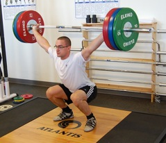 Level 7 Muscle Activation Exercises include the snatch and rope climbing. Shown lifting is Paul Dumais, who snatched a Junior Commonwealth Record of 150 kilos in the 85-kilo class at the 2010 Junior World Championships.