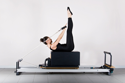 The Reformer is one of the basic pieces of exercise equipment used to perform Pilates. Resistance is provided by springs.