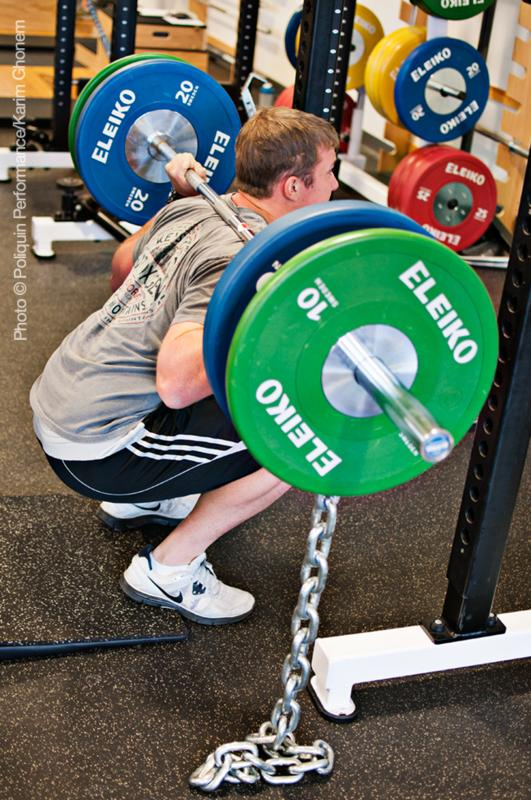 Using lifting chains is one method to encourage athletes to squat lower.